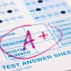 Standardized test with A+ grade displayed